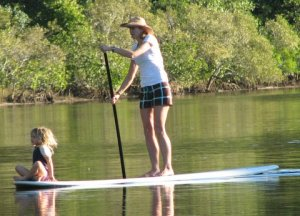 Me and my daughter stand up paddle surfing in Noosa